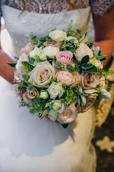 Bouquet made with roses, spray roses and green bell