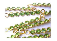 6 Vintage Swarovski crystal connector beads, 6 light green rhinestones in metal gold color setting- RARE by oritdotan on Etsy https://www.etsy.com/listing/104916405/6-vintage-swarovski-crystal-connector