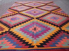 Check out this item in my Etsy shop https://www.etsy.com/listing/529064319/vintage-turkish-kilim-rug-handwoven-rugs