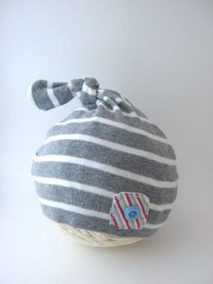 Upcycled Newborn Hat. I might could make this out of a shirt sleeve