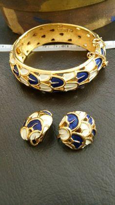 Check out this item in my Etsy shop https://www.etsy.com/it/listing/252333791/marcel-boucher-vintage-set-bangle