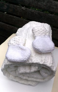 Check out this item in my Etsy shop https://www.etsy.com/listing/252066974/white-knit-baby-blanket-knit-chunky-baby