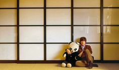 """sirpeter64: """" Your John Lennon in Japan. Decent scan! 1965. Robert Freeman. """" Fall 1964 - The first photograph published of John Lennon at his new home, Kenwood, posing in the master bedroom with Julian's panda bear."""