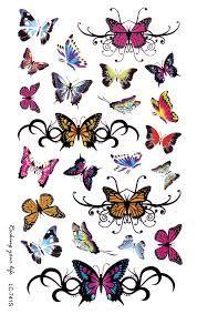 Afbeeldingsresultaat voor tattoo lotusbloem en vlinder voet