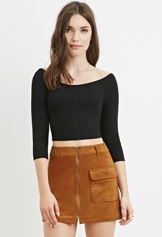 A crop top crafted from finely ribbed knit with a scoop neckline and 3/4…