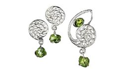 The transcendent beauty of the nautilus shell is reflected in the charismatic design of the Nautilus Set, which is set off by the sublime green of the peridot. The contrasting textures of polished and raw peridots combine to give the pieces a depth that's exciting, yet elegant. The set offers versatility through a spectacular pendant that can be worn as a brooch; both options match perfectly with a pair of earrings that look equally stunning worn on their own