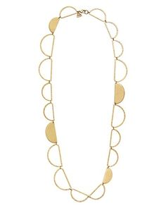 Get glowing with this long link Necklace from the K & R Collection. Featuring unique half moon designs, this Brass Necklace layers well with short Necklaces and elongates boxy shift shirts and dresses.