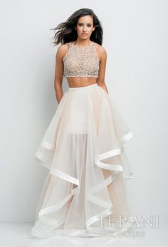 Beautiful 2-piece ensemble featuring a nude, crystal embellished illusion midriff top and sheer, gathered mesh skirt with ribbon accented high-low hemline