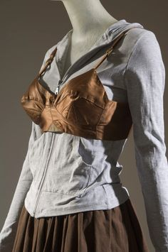 Vivienne Westwood ensemble made in brown satin cotton, gray crochet knit and brown suede. Museum at FIT New York. Exhibition Plan, Museum Exhibition, Quirky Fashion, Vivienne Westwood, Fashion History, Sportswear, Two By Two, Fitness, How To Wear