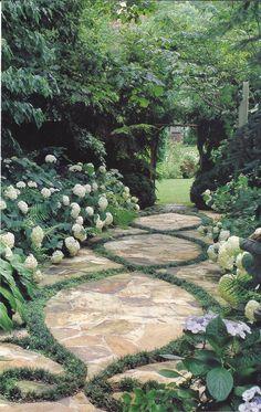path design - irregular flagstone with decorative plant inlay flanked with hydrangeas
