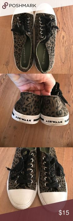 Air walk size 8 1/2 animal print converse EUC!!!! Very clean!!! Adorable and looks awesome with skinny jeans. Black and olive green animal print converse style shoe. Air Walk Shoes Sneakers