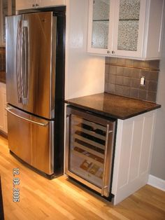 wine fridge and glass cabinets above
