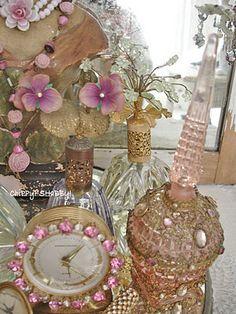 with lots of vintage perfume bottles & assorted fru-fru