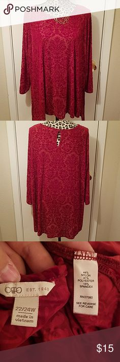 CATO Velvet Damask Print Blouse Item is in excellent condition. No rips, stains, snags or tears. The top itself is sheer and I would recommend a tank top underneath. Has a slight hi lo and is very stretchy Cato Tops Blouses