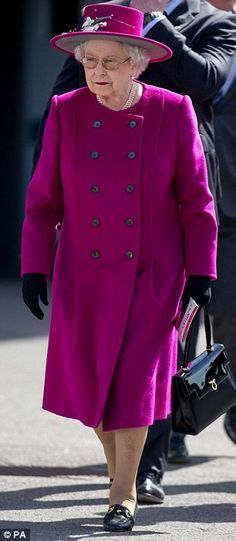 Lovely: The Queen was resplendent in a cheerful fuchsia coat and a matching hat