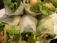 Pad Thai Spring Rolls Recipe Appetizers with tamarind juice, fish sauce, lime juice, palm sugar, green papaya, noodles, rice, grapeseed oil, garlic cloves, large shrimp, spring roll wrappers, romaine lettuce leaves, cilantro leaves, mint leaves, carrots, japanese cucumber, peanuts