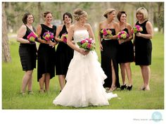 Black bridesmaid dresses. Looks great even though they don't match.