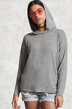 A soft heathered knit hooded top featuring long dropped sleeves and a surplice neck.
