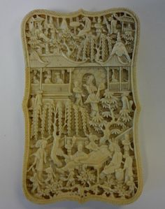 A large Chinese ivory calling card case. Finely carved with great intricacy on all sides depicting village scenes and figures from mandarin life.