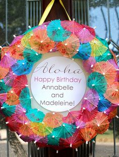 Fun drink umbrella wreath decoration for an adult luau birthday party