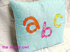 How fun is this pillow?! I made this to be used in a nursery or a children's room. The letters are hand drawn and fused on to lovely blue fabric. It is also machine appliqued. The back has an envelope style closure for easy cleaning.