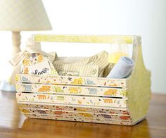 Give a basic wooden basket a makeover with paint, patterned paper, and a bit of imagination. After painting the piece, trim paper strips to fit the basket and use decoupage medium to adhere and seal. Add a decorative tag and fill the basket with goodies. Cute Gifts, Diy Gifts, Wooden Basket, Decoupage, Kids Wood, Baby Design, Nursery Design, Paper Decorations, Baby Items