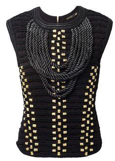 BALMAIN H&M Un top noir et doré