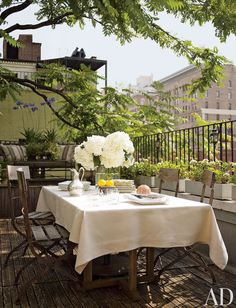 "upintheatticus: ""Nina Griscom and Leonel Piraino's rustic outdoor space One of a Manhattan apartment's three terraces is outfitted with French café chairs for dining. photo: Eric Piasecki article: Shifting Gears, in AD February 2012 location: New..."