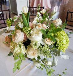 Soft peach blush cream centerpiece.  Peonies, rananculus, lilac, garden roses and hydrangea.   Inbloomltd.