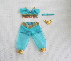 Princess Jasmine Inspired 4 Piece Set. Sheer off-the-shoulder bikini top with gold straps.