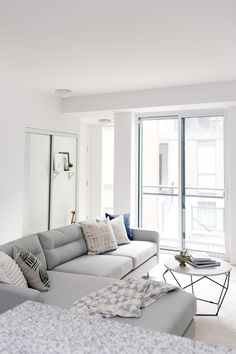 Modern simplistic living room: Read More on SMP: http://www.stylemepretty.com/living/2016/09/14/learn-the-art-of-scandinavian-style-with-this-toronto-home-tour/