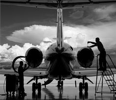 A Cessna Citation gets a tuneup. tags: aircraft, cessna, photography, business jet, aviation, storms, clouds