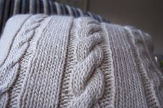 Free Ravelry pattern for a cable cushion