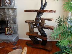 Rustic live edge table features burl wood slabs and driftwood