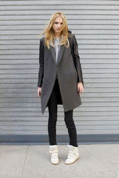 Great casual street style look: Wool jacket with leather sleeves and hidden-wedge sneakers.
