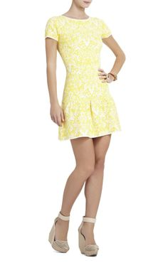 I love the cut and style of this dress but I'd wear it with different shoes and not in yellow...