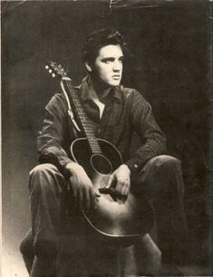 Elvis and his guitar