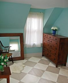 Turn a worn-out wood floor into a warm cottage classic with a simple checkerboard pattern