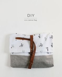 DIY Fashion forward Eco Canvas fold-over bag with leather detailing. Visit http://www.sewinlove.com.au/category/fashion/accessories-fashion/ for more DIY Bags and Purses ideas.