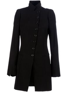 black linen/wool blend trench coat from Ann Demeulemeester featuring a slanted front closure with a front button fastening, notched lapels, long sleeves with buttoned cuffs, top stitch detailing to the rear and two side jetted pockets.