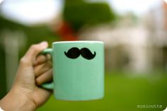 DIY Mustache Cup:   1. Take a cup   2. Make a point in the middle of the cup   3. Draw a mustache   4. Fill the mustache with color   Enjoy!
