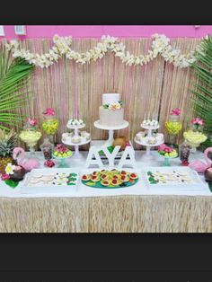 Sweet table - bamboo backing grass table skirt, white simple table. Flamingo & palm leafs