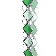 Perfect for May birthdays, an emerald inspired stained glass suncatcher