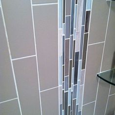 Recent installation of Stainless Glass and Stone mosaic in taupe and  Retro 4x16 matte in Tender Grey  #walltile #mosaic #subwaytiles by giotile