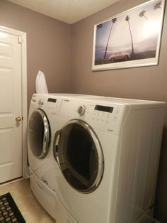 Laundry room, we didn't realize how big these front loaders were going to be, ha ha