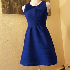 Royal blue fit and flare dress Royal blue dress. Sleeveless. Fit and flare. Textured, stretchy material. Adorable bow on back. Wear woth a sweater and geels for a wedding or jacket and boota for work. Soooo cute! Candie's Dresses Asymmetrical