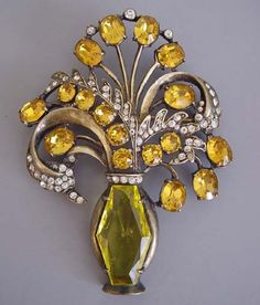http://www.pinterest.com/joliesarts ∗ ♕Simply Divine #jewelry ~ Sterling silver yellow swarovski crystal Eisenberg brooch