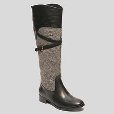 """Tommy Hilfiger womens boot. Two of our favorite fall things—equestrian styling and herringbone wool—come together in a beautifully crafted, incredibly comfortable boot. Our designers deem them a must-own (and it's easy to see why).• Leather pieced with herringbone fabric. • 1"""" heel, 15½"""" calf circumference (measurement taken from a size 9).• Elastic goring, half-zip, strap detail with functional buckle. • Imported."""