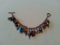 An all copper charm bracelet.  You can just keep adding more and more charms!