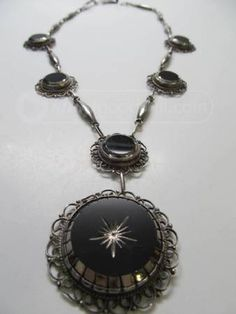 Another amazing vintage Mexican Sterling piece that has made its way into our clutches.